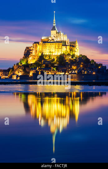 View of famous Mont-Saint-Michel by night, France. - Stock-Bilder