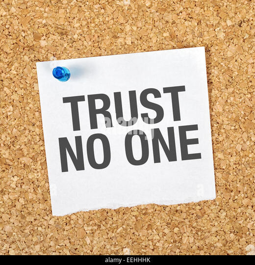 Trust No One Reminder Note Pinned to a Cork Memory Bulletin Board. - Stock Image