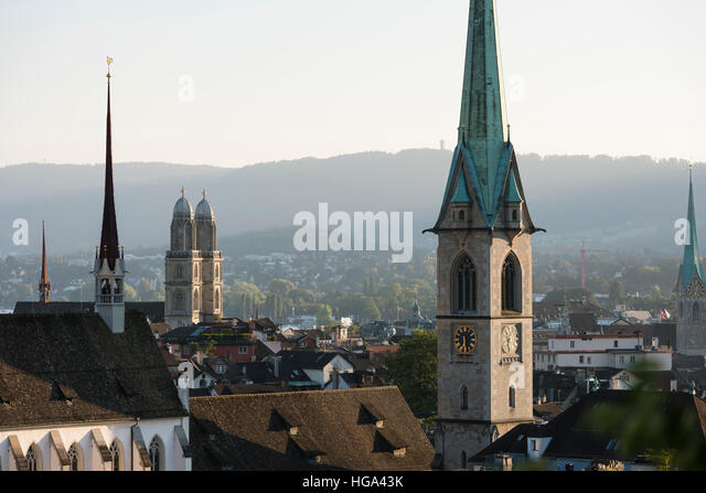 Zurich city panorama with Grossmunster cathedral, Predigerkirche and Fraumunster in the setting sun. - Stock Image