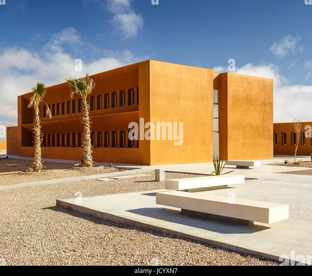 Oblique view across landscaped paths with benches and buildings. Laayoune Technology School, Laayoune, Morocco. - Stock-Bilder