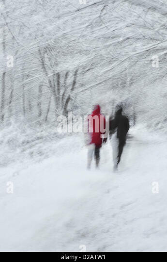 Snow - Reading, Berkshire,  United Kingdom. 18.01.2013   Impression captured  of a snow flurry, with  two people - Stock Image