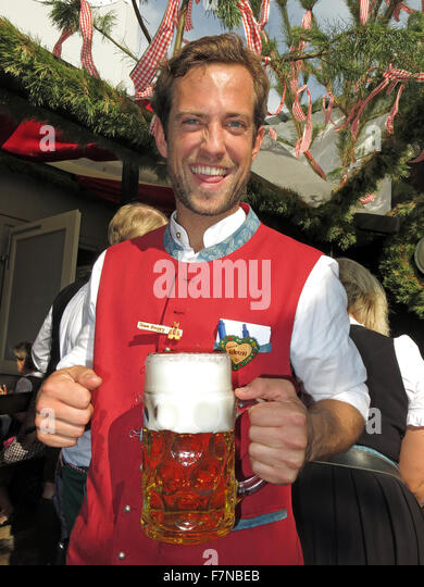 Oktoberfest server with lager bier stein, Munich,Germany - Stock Image