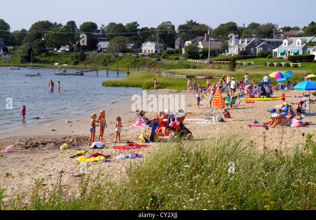 Massachusetts Cape Cod Chatham Oyster Pond Beach sunbathers family water - Stock Image