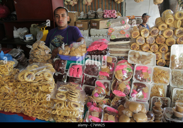 Managua Nicaragua Mercado Roberto Huembes market shopping marketplace baked goods vendor stall cookies traditional - Stock Image
