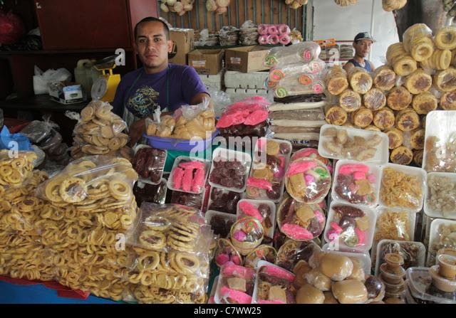 Nicaragua Managua Mercado Roberto Huembes market shopping marketplace baked goods vendor stall cookies traditional - Stock Image