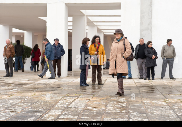 Nossa Senhora da Piedade church courtyard with group of people waiting Loulé Algarve Portugal Mediterranean - Stock Image