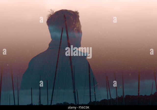 Fisherman double exposed with boasting masts - Stock Image