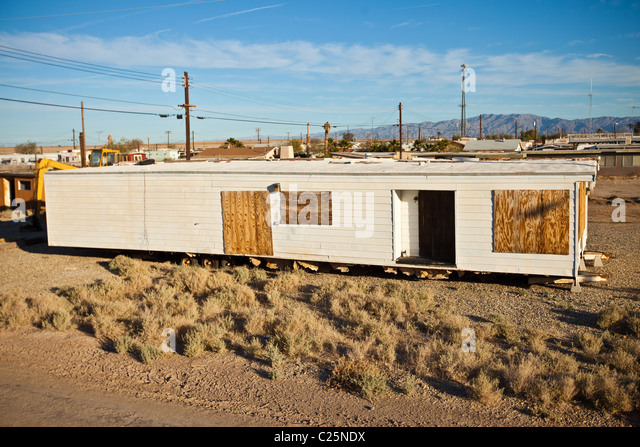 Remains of a trailer home Salt along the coast of the Salton Sea at sunrise Imperial Valley, CA. - Stock Image
