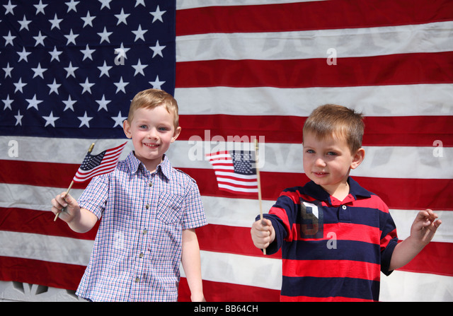 Two young boys waving American Flags - Stock-Bilder