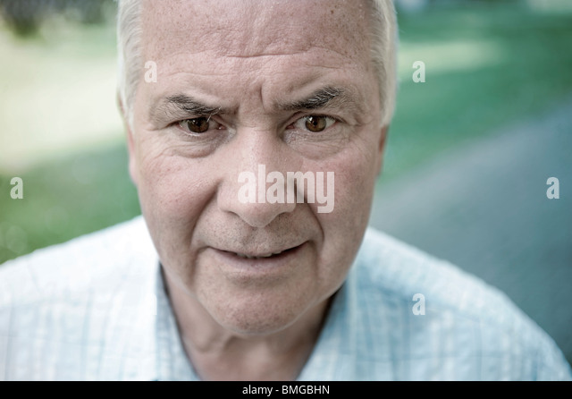 portrait old man grey hair - Stock Image