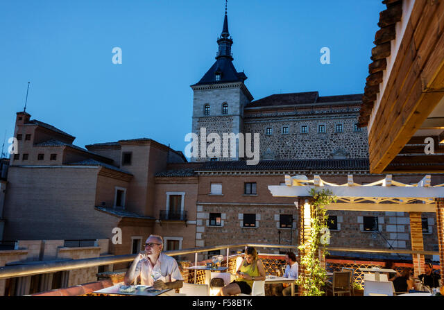 Spain Europe Spanish Hispanic Toledo Restaurante Carlos V hotel restaurant terrace teraza rooftop view Alcazar tower - Stock Image