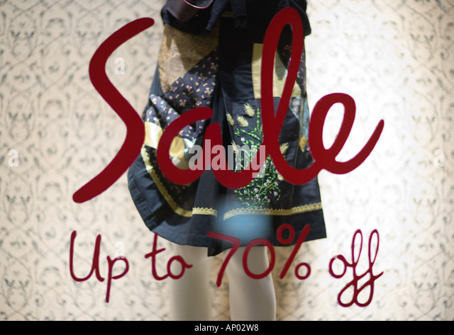 Sale sign on shop window - Stock-Bilder
