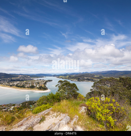 The view from Mount Paku, Tairua, looking down on Pauanui, Coromandel, New Zealand. - Stock Image