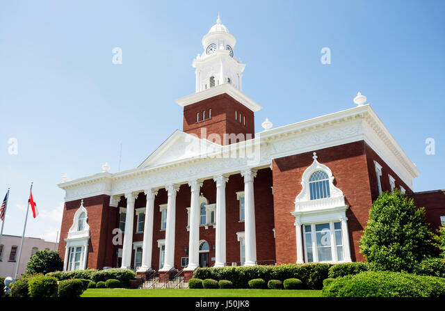 Alabama Opelika Historic District Lee County Courthouse 1896 Corinthian column building law justice white clock - Stock Image