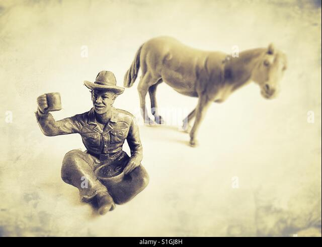 Plastic cowboy and horse toys. - Stock Image