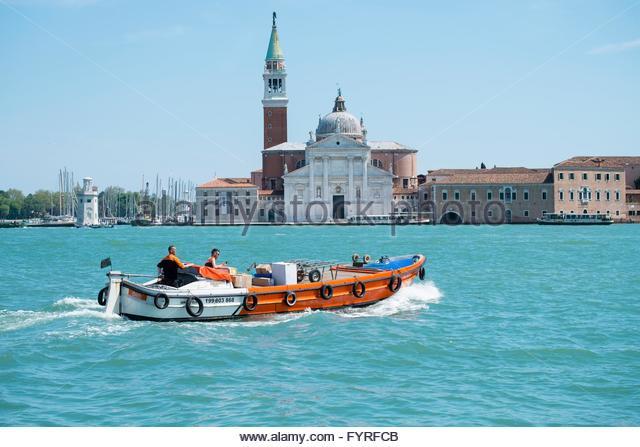 TNT delivery boat travelling to  La Giudecca island - Stock-Bilder