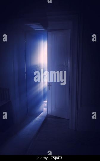 Blue rays of light behind the door - Stock-Bilder