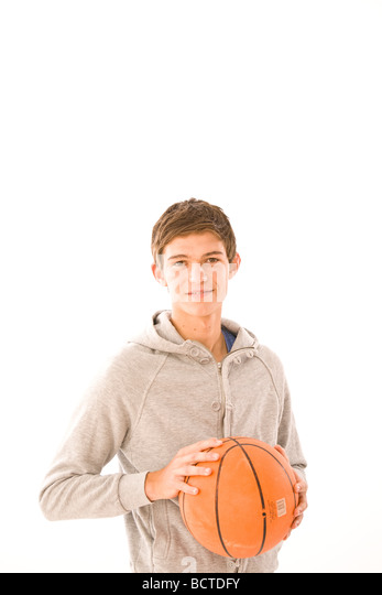 Portrait of a boy with a basketball - Stock Image