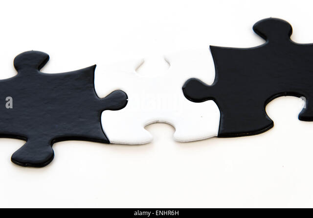 black and white puzzle pieces contrasting - Stock Image