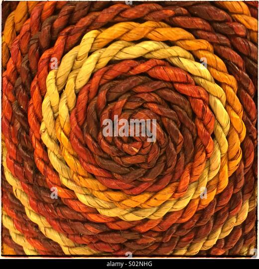 Multi coloured ropes twisted to form spirals - Stock Image