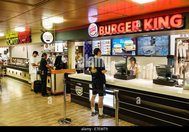 Honolulu Hawaii Hawaiian Oahu Honolulu International Airport HNL terminal concourse gating area Burger King fast - Stock Image