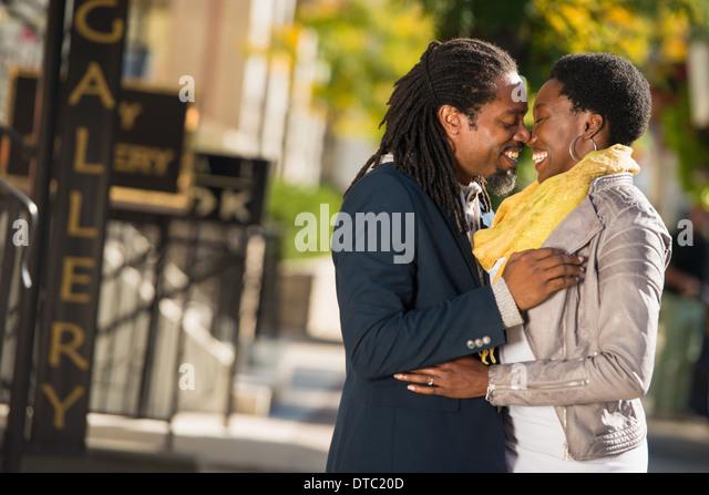 Tourist couple outside hotel, Toronto, Ontario, Canada - Stock Image