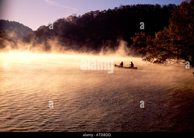Canoeing Bear Lake North Carolina In The Morning Fog - Stock Image