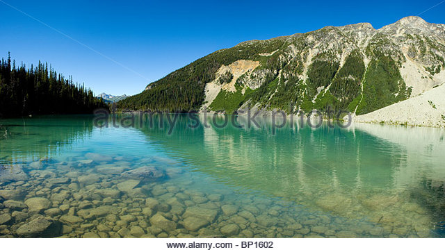 Glacier water of Upper Joffre Lake, Joffrey Lakes Provincial Park, British Columbia, Canada - Stock Image
