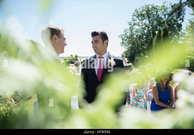 A groom and best man waiting for the bride prior to the wedding service - Stock Image