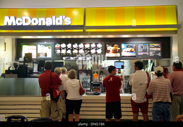 Texas Houston George Bush Intercontinental Airport IAH terminal concourse gate area McDonald's fast food restaurant - Stock Image