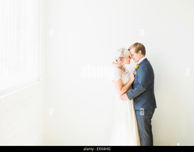 Newlywed couple embracing - Stock Image
