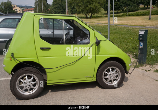 Electric car being charged at a public charge point, Norway Oslo - Stock Image