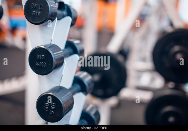 many dumbbells are at stand  the gym - Stock Image