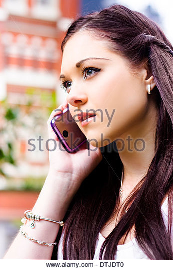 Face Of A Beautiful Business Woman On A Smart Mobile Teleconference Phone Call To An Executive Client When Standing - Stock Image