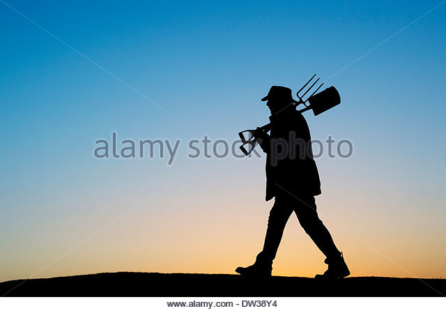 Gardener walking with spade and fork. Silhouette - Stock-Bilder