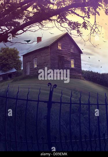 Abandoned haunted house on a hillside - Stock Image
