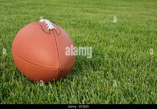 American Football ball outside close up - Stock Image