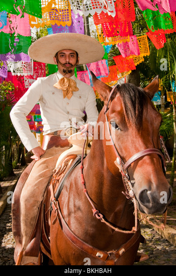 Guadalajara, Mexico, Charro (Mexican Cowboy) riding horse down cobblestone street, Club Charro Lienzo, Jalisco - Stock-Bilder