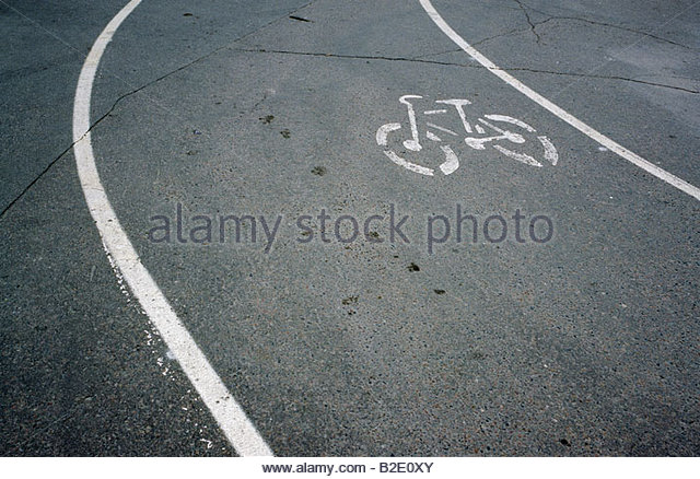 Bicycle lane sign on the road - Stock Image