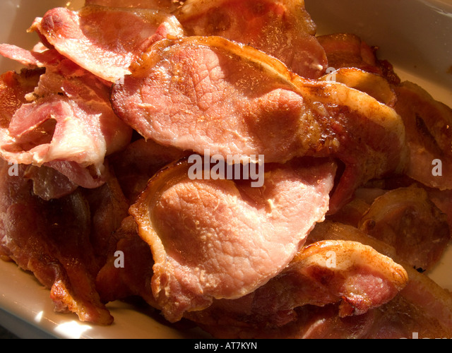 Pile of cooked rashers of bacon - Stock Image