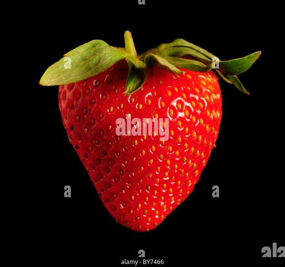 Single red strawberry against black background. Square - Stock-Bilder