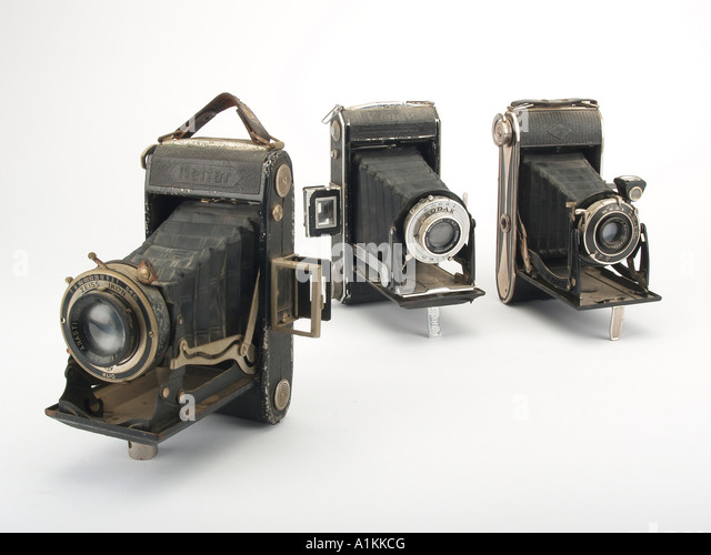 an assortment of old style film cameras - Stock Image