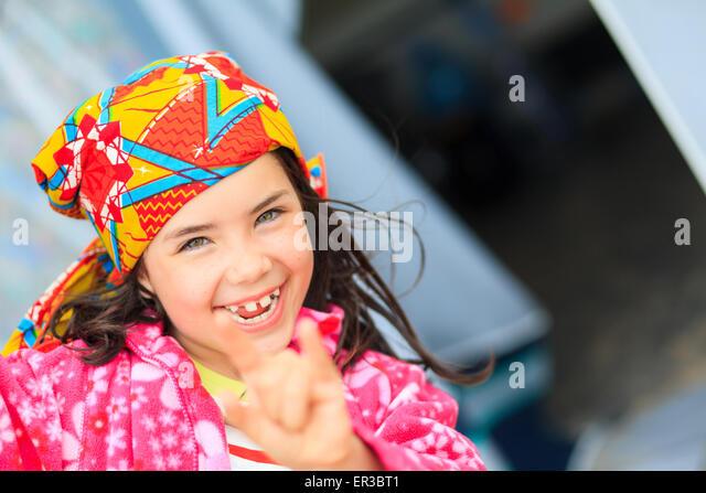 Portrait of a smiling girl gesturing horn sign - Stock-Bilder