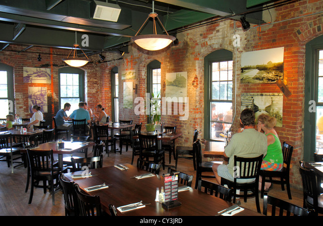 Maine Topsham renovated mill interior Sea Dog Brewing Company restaurant tables historic - Stock Image