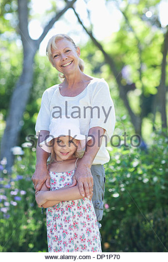Grandmother and granddaughter in garden - Stock Image
