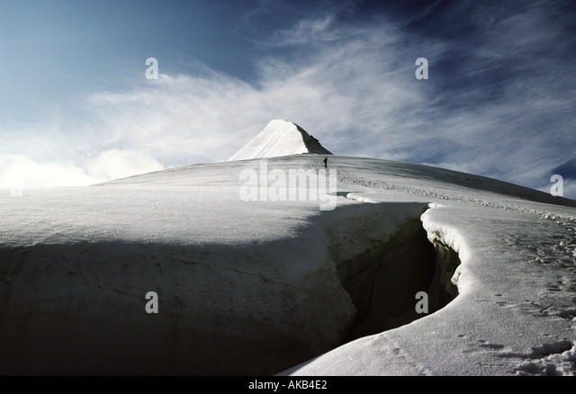 A crevasse below the summit ridge of the Hohe Wilde, Ötztal Alps, Austria - Stock Image