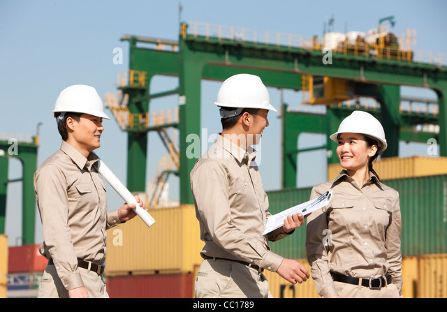 shipping industry workers talking - Stock Image