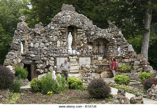 Arkansas Pocahontas St. Paul's Catholic Church grotto man woman religion Virgin Mary Marian altar statue rock - Stock Image