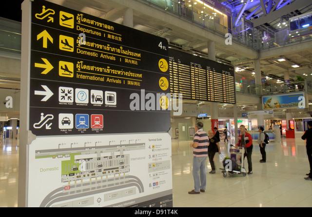 Bangkok Thailand Suvarnabhumi International Airport BKK terminal information directions sign board symbols bilingual - Stock Image