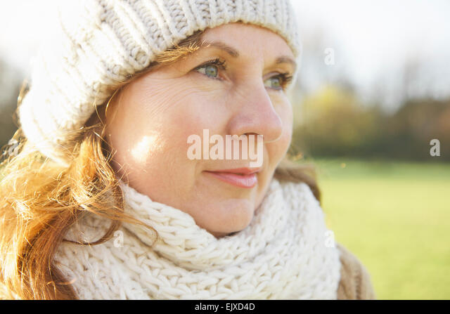 Woman Wearing Wool Hat and Scarf Outdoors - Stock Image